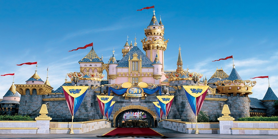 "SLEEPING BEAUTY CASTLE –- Gowned in swaths of richly colored royal banners, bejeweled with precious stones, trimmed in gold and topped by five regal turret ""crowns,"" representing five decades of wondrous achievement, Sleeping Beauty Castle will glow with magic as never before. The castle"